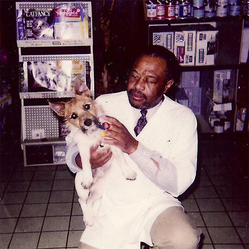 Throwback picture of Veterinarian Dr. Jerome B. Williams with a dog